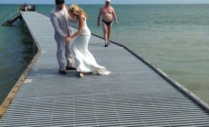 Awesome Dude in Speedo Photobombs Romantic Wedding Portrait