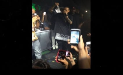 Chris Brown Receives Panties on Stage, Not Deterred By Boob Sweat