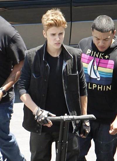 Justin Bieber on a Segway