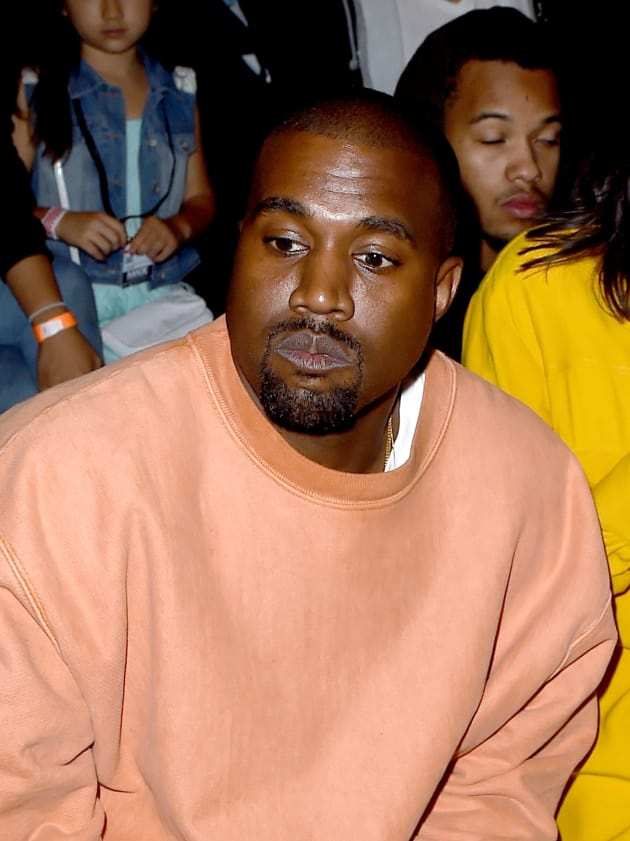 Kanye West in Orange Sweatshirt