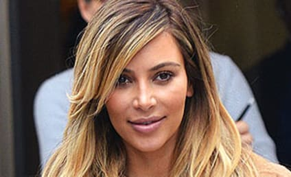 "Kim Kardashian Wears ""Nori"" Necklace, Short Skirt in Paris"