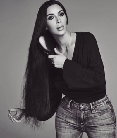 Kim Kardashian Combs Hair