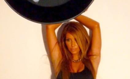 Kim Kardashian Flashes Back, Poses as a Blonde