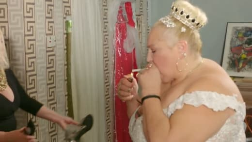 Angela Deem smokes in her wedding dress