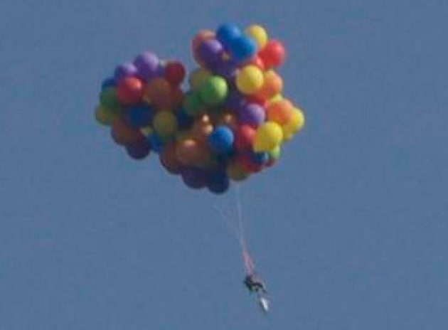 Man Rides Lawn Chair Beneath 110 Helium Balloons Flies