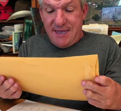 Matt Roloff Holding an Envelope
