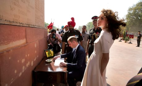 Prince William Signs a Guest Book, Kate Middleton Battles The Wind