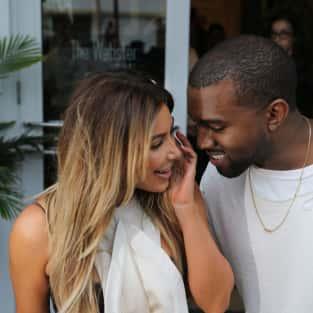 Smiling Kanye West and Kim Kardashian