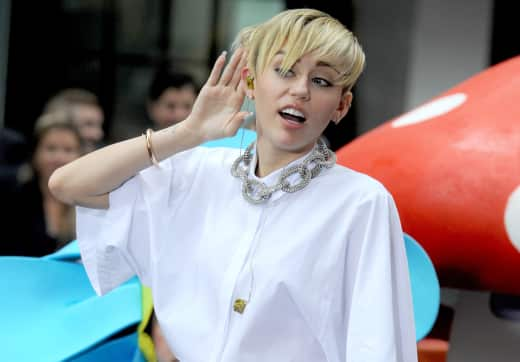Miley Cyrus Makes Like Hulk Hogan