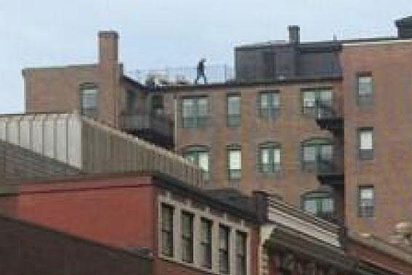 Mystery Man on Roof