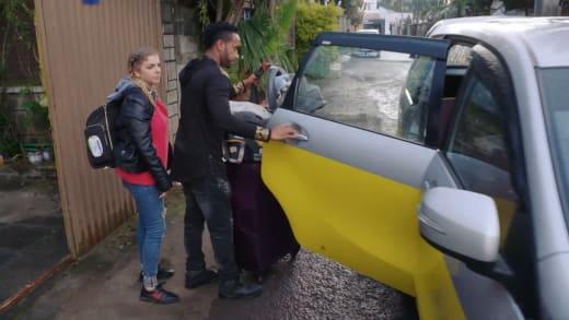 Biniyam Shibre and Ariela Weinberg pack the car