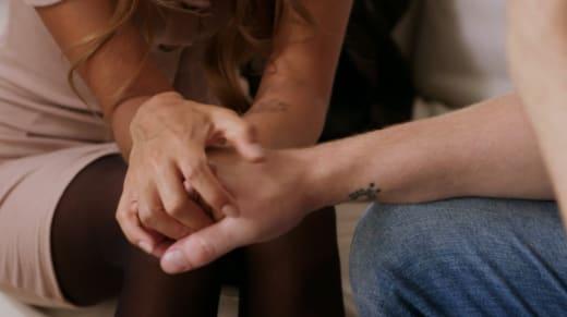 Tim Clarkson and Melissa Zeta hold hands before leaving