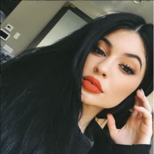 Kylie Jenner with black hair and red lips