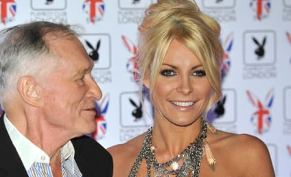 Hugh Hefner and Crystal Harris Engage in Literal Dog Fight