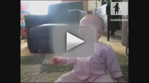 Baby Girl Laughs at Dog Eating Popcorn