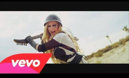 "Avril Lavigne, Danica McKellar Make Out in ""Rock N Roll"" Music Video"