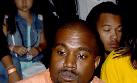 Kanye West in Orange Sweatshirt