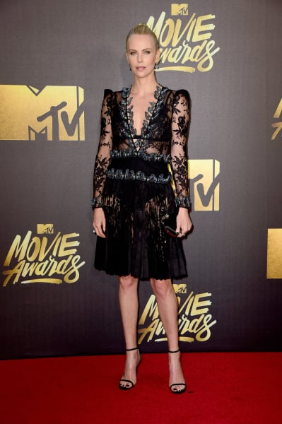 Charlize theron talks 30 pound weight gain i am very fat right charlize theron 2016 mtv movie awards voltagebd Choice Image