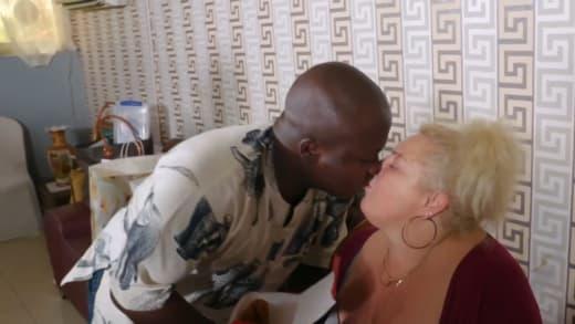 Angela Deem and Michael Ilesanmi are kissing