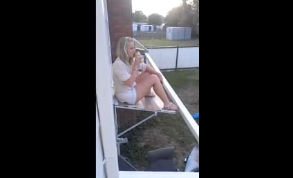 Drunk Girl Falls From Flimsy Window Awning; Precious Beer Lost