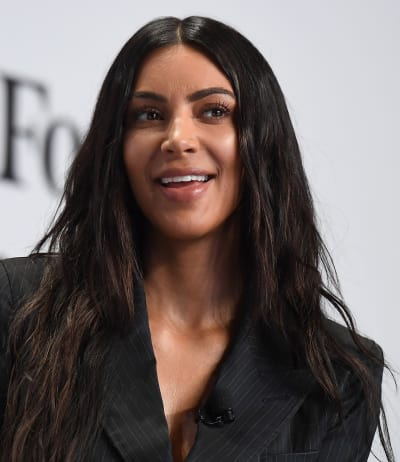 Kim Kardashian Has a Smile