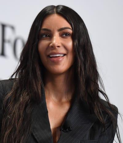 Kim Kardashian Has a Smile