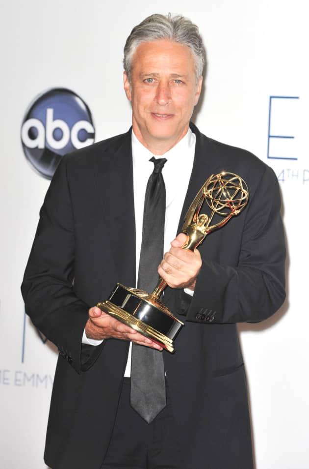 Jon Stewart with an Emmy
