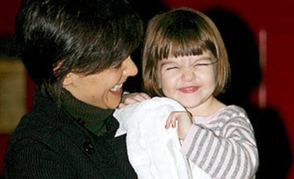 Suri Cruise and Katie Holmes Share a Smile
