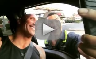 The Rock Fan Stops Traffic for Selfie: See It Here!