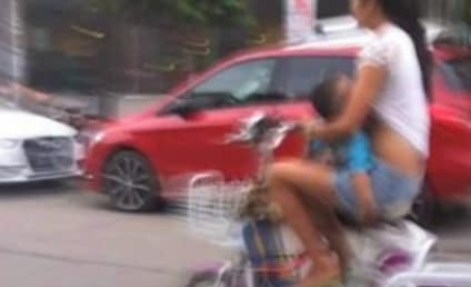 Woman in China Cited for Breastfeeding Son on Moped