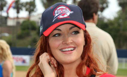 Dogg Days of Wrestling: Snoop Clobbers Opponent, Slobbers on Maria Kanellis