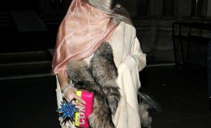 "Lady Gaga Rocks Burqa, Furs, ""C--t"" Bedazzled Handbag"