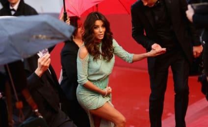 Eva Longoria Wardrobe Malfunction Heats Up Rainy Cannes