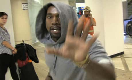 Kanye flipping out at the paparazzi ...