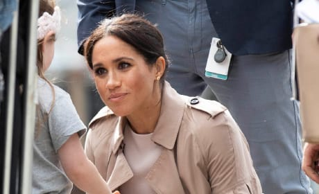 Meghan Markle Bends Down