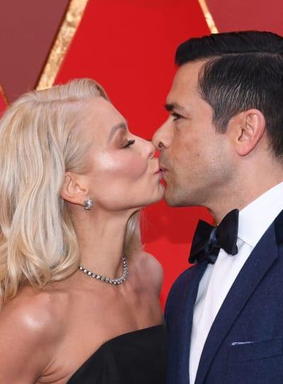 Kelly Ripa and Mark Consuelos Kiss