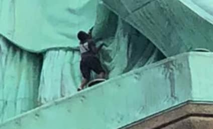 Woman Scales Statue of Liberty in Protest of Donald Trump