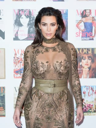 Kim Kardashian Barely Covers Up