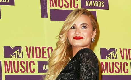 Grade Demi Lovato as an X Factor judge.