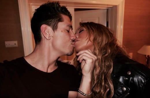 Mariah Carey and Bryan Tanaka Kiss