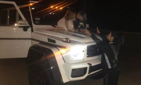 Kourtney Kardashian with Penelope and Reign