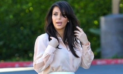 Kim Kardashian, Baby Bump Film Show, Struggle Not to Bust Out of Clothes