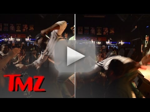 50 cent punches female fan during concert