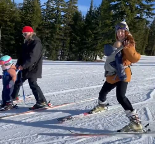 Audrey Rulloff skates with baby Bodie in belts, without a helmet