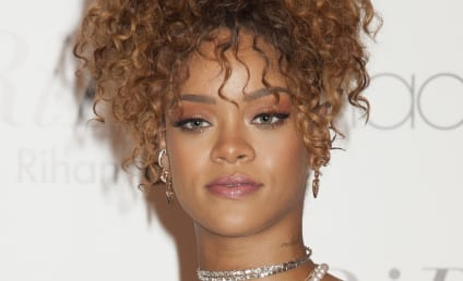 Rihanna: Naked & Holding a Baby in Weird New Pic