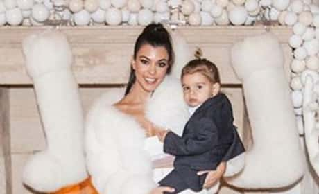 Kourtney Kardashian Holds Son