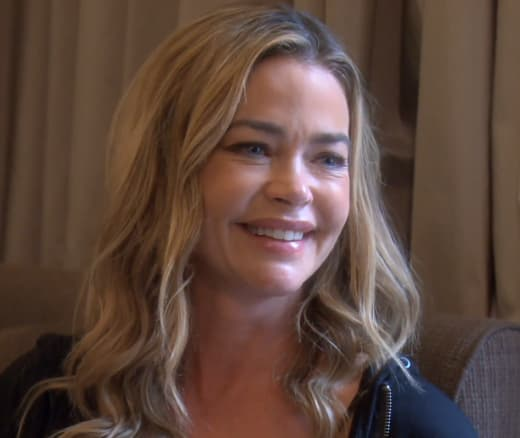 Denise Richards Smiles and Plans to Sue