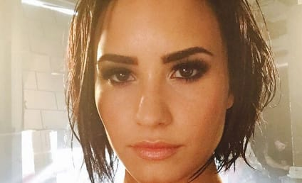 Demi Lovato: Topless, Sitting on an Inflated Banana!