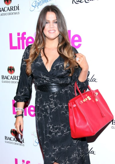 Khloe Kardashian with a Red Purse