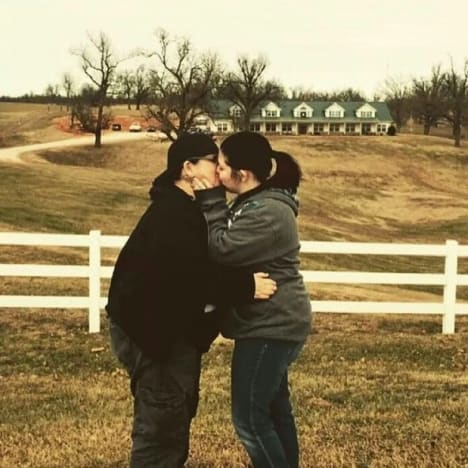 Lesbian Couple Kisses in Front of Duggar House